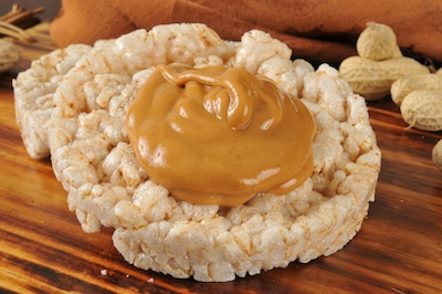 bigstock-Peanut-Butter-On-Rice-Cakes-540494681